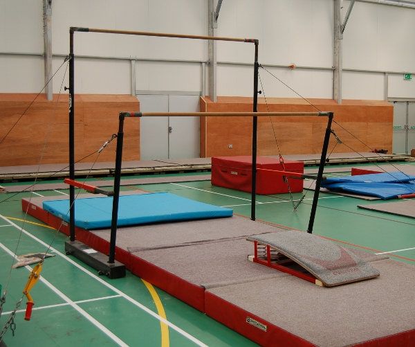 We have a set of Uneven Bars, complete with competition landing mats