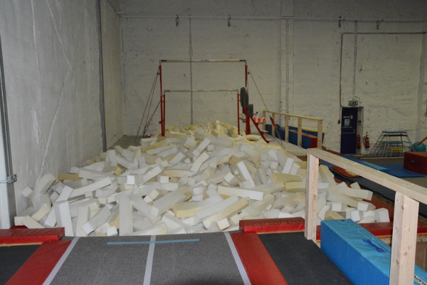 The pits were added in Jan 2014 and have uneven bars and a spotting platform