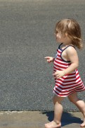 Young Girl in Red Dress Walking