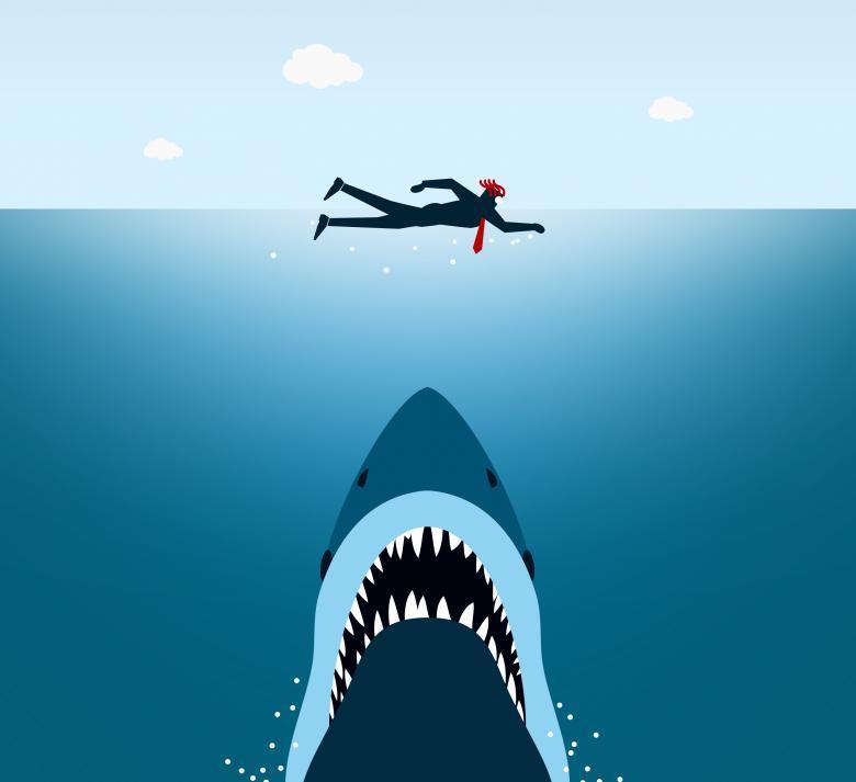 Businessman Under Shark Attack Jaws Free Stock Photo