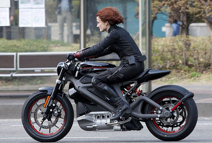 This image has clearly been altered:  We have it on good authority that women cannot ride motorcycles.
