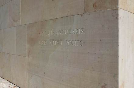 """The cornerstone facing the cathedral is worth special mention: it is a massive block 2.50 x 1.50 x .50 cm and bears the inscription """"This is where a cornerstone was laid in 2012""""."""