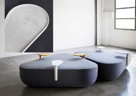 """Refill"": waiting-room seating-system with rest table for mobile phones and charging station in marble."
