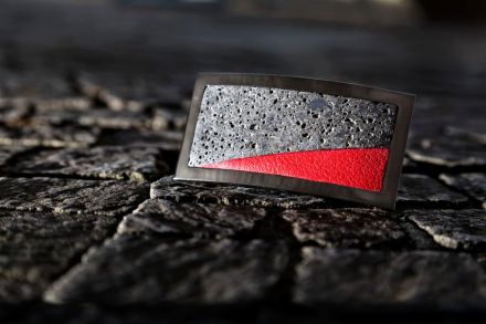 "... ""Lava"" combines dark volcanic material and bright red leather, framed in Ruthenium."