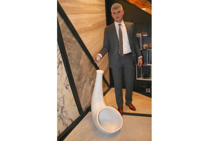 One of Stone Studio's products is a marble megaphone able to amplify sound emanating from a palm-sized sound-source. The picture shows Burak Alimoglu demonstrating the function.