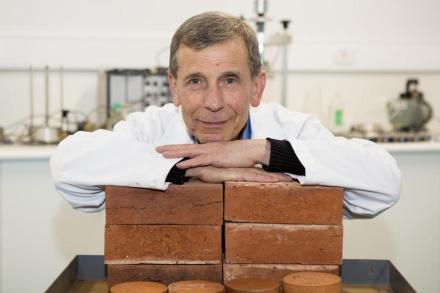 Dr Abbas Mohajerani has shown that bricks with 1 per cent cigarette butt content as pictured here can help the environment. Photo: RMIT University