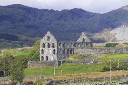 Not a cloister and not a cathedral: Ynys y Pandy slab mill with Gorsedda quarry in the background (right). Background right, the Gorsedda quarry. Crown copyright: Royal Commission on the Ancient and Historical Monuments of Wales