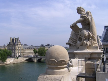 On the roof of the Musée d'Orsay: Left: the Louvre. Source: Wikimedia Commons / Joe Shlabotnik