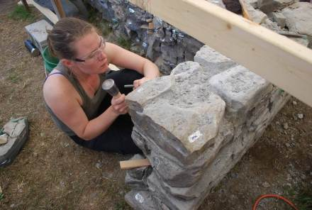 Second year Willowbank student Justine Southam carefully removes original hearthstones. Photo: Crystal Bossio, 2016