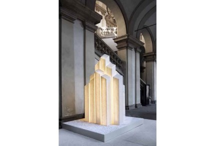 "Marco Piva installed a ""City of Light"" for Casone Group comprised of sky scrapers illuminated by night. The material used was Sivec Marble bathed in a very cold light. Photo: Andrea Martiradonna"