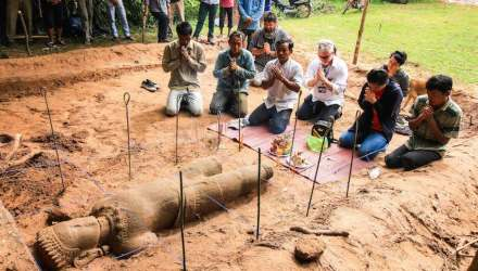 The archaeology team which made the find holds a religious ceremony to ask the spirit protecting the site permission to move the statue to a museum. Photo: Ea Darith
