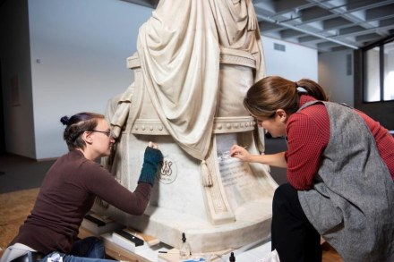 Objects conservators Marianne Schmeisser (left) and Corey Riley (right) cleaning the base of the statue Saul under the Influence of the Evil Spirit.