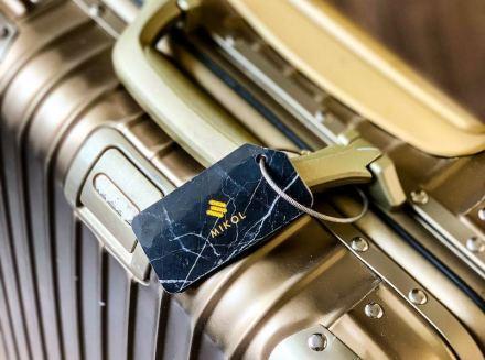 Luggage tags made with marble by Mikol Marmi company. Photo: Mikol Marmi