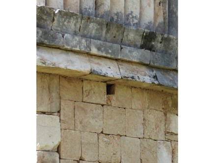 Many Mayan buildings have small square holes just below the cornice all around and in regular intervals.