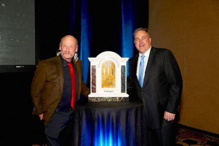 Dan Doyle (left) receives the 2019 Natural Stone Craftsman of the Year Award.
