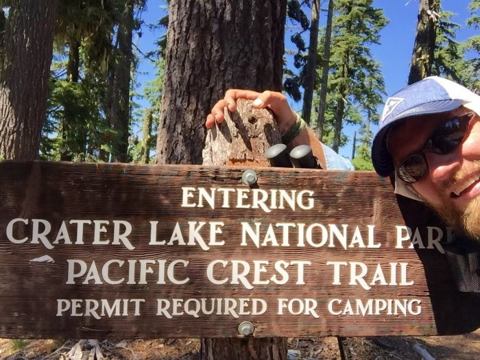Mountain Man at Crater Lake National Park boundary sign