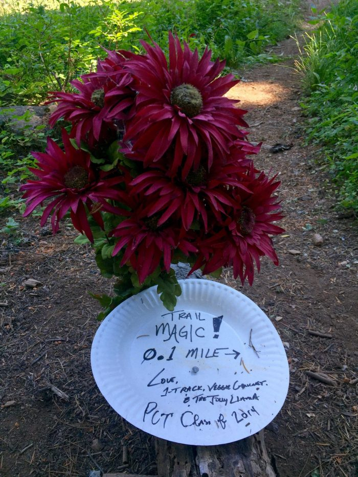 Handwritten message on a paper plate inviting us to trail magic at Le Bistro