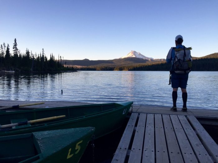 Mountain Man looking at Mt. Jefferson from the dock at Olallie Lake