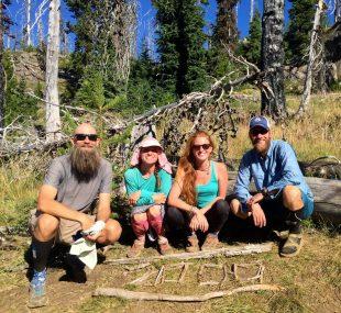 Beardoh Sweet Pea Gazelle and Mountain Man posing at the PCT 2000 mile marker