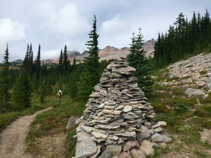 Giant rock cairn next to the Pacific Crest Trail in Goat Rocks Wilderness