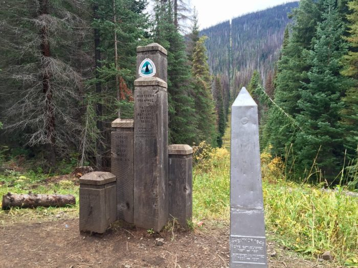 Wooden border posts at PCT northern terminus and US-Canada border obelisk