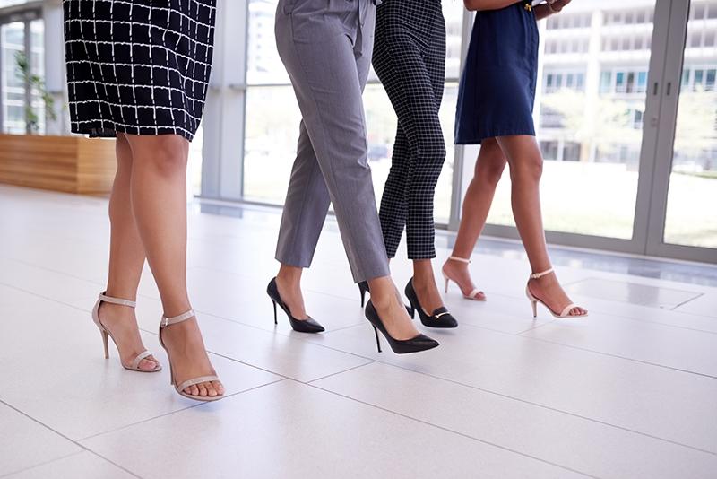 Group of four walking in heels