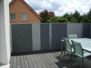 Brise-vue grâce à une clôture minérale Stonefence