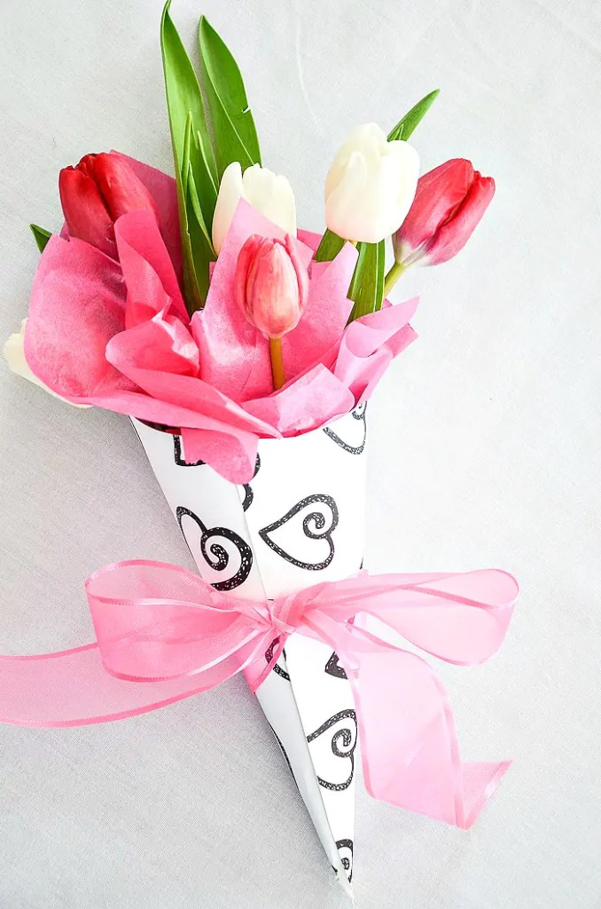 paper Valentine cone with tied with a pink ribbon