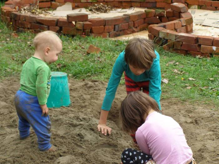 The kids loving the sandpit that was going to be a garden bed. Need I say more about the state of our soil!