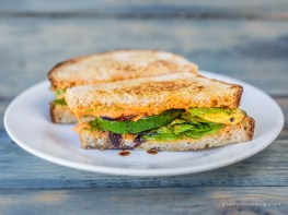 Roasted red pepper hummus, roasted zucchini & squash, & spinach, w/balsamic drizzle on Bosque Baking sourdough