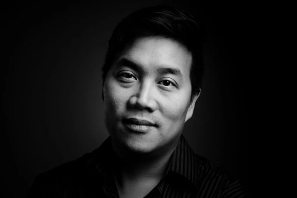 Portrait of Justin Woo - Shot with an ultra-portable studio: one light and one stand