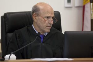 Judge Martin Colin presides over a hearing on Thursday, August 20, 2015 at the South County Courthouse in Delray Beach. Judge Colin's wife Elizabeth Savitt, who is a professional guardian, was simultaneously participating in a hearing in another courtroom with Attorney Sheri Hazeltine. (Madeline Gray / The Palm Beach Post)