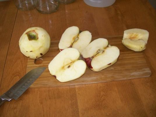 Apple pared, halved, cored