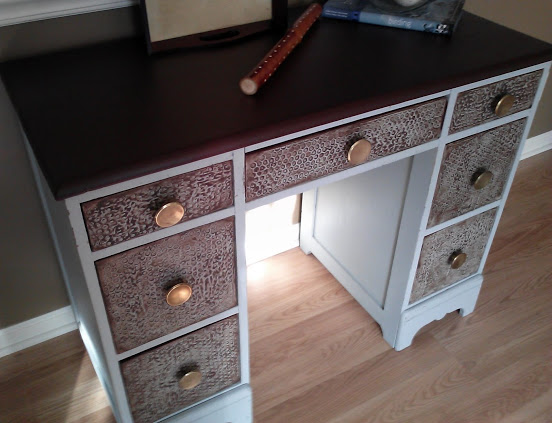 salvaged wood desk with faux leather top and bubble wrap plaster texture