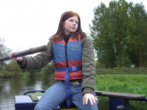 Photo: Jade steering the boat