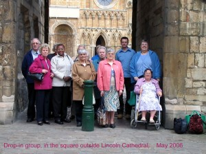 Group standing outside the west gate of Lincoln Cathedral