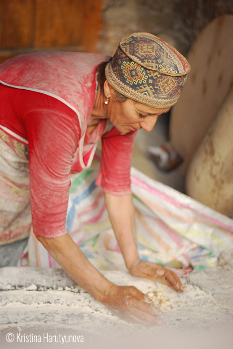 © Kristina Harutyunova (Yerevan, Armenia). Woman during the work in one of Tonratun (Lavash making), Yerevan.