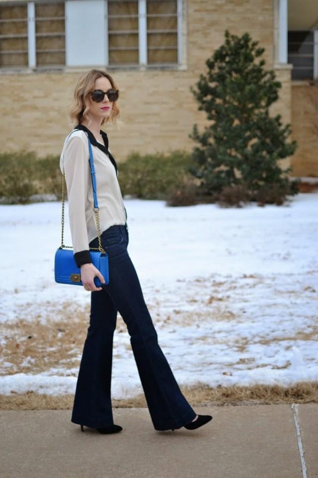 Black and white blouse, blue purse, flare jeans, Karen Walker Super Duper, Ditto, thredUP