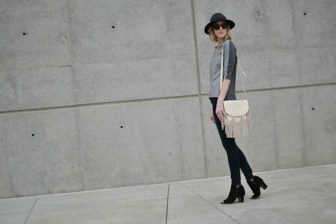 grey top, black jeans, fringe bag, fringe booties