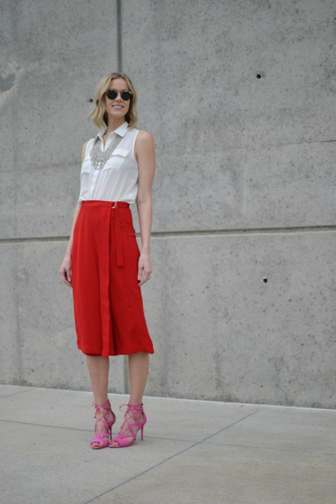 red culottes, white blouse, silver bib necklace, pink heels