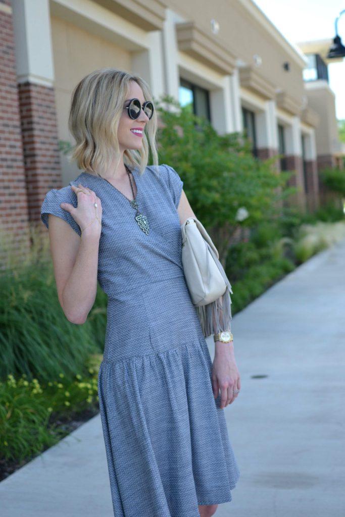 Shabby Apple dress, Row sunglasses, fringe bag