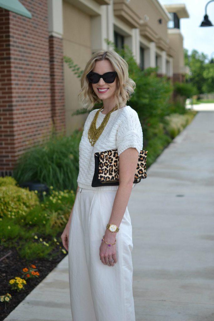 cream culottes, cream sweater, gold bib necklace, leopard clutch
