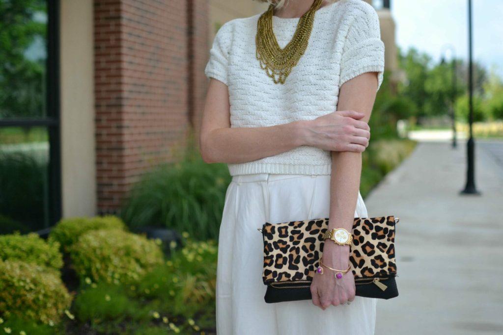 cream culottes, cream sweater, mules, gold bib necklace, leopard clutch details