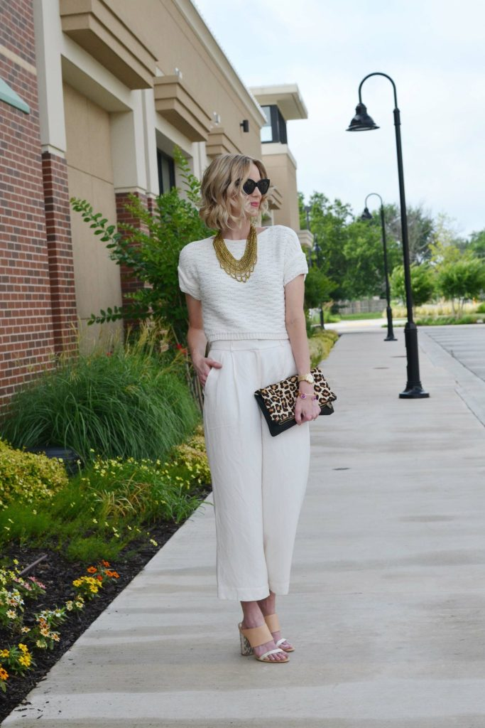 cream culottes, cream sweater, mules, gold bib necklace, leopard clutch