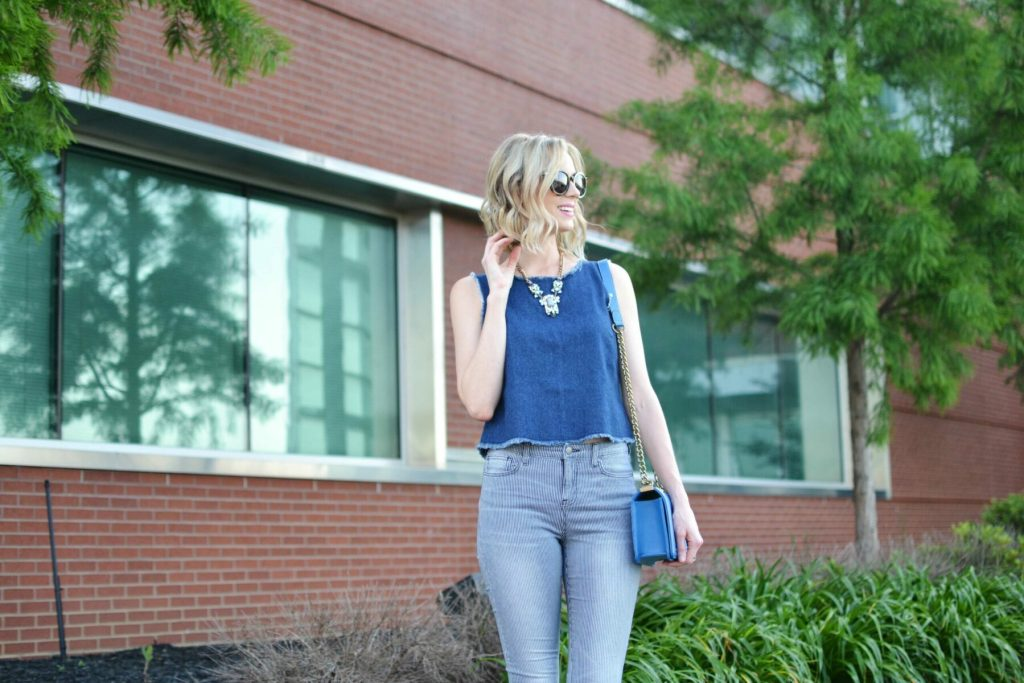 denim tank, striped jeans, sandals, blue bag, karen walker sunglasses