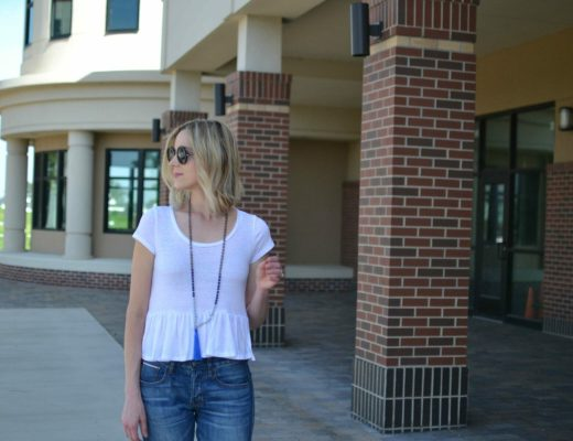 jeans and a tee, round sunglasses, tassel necklace