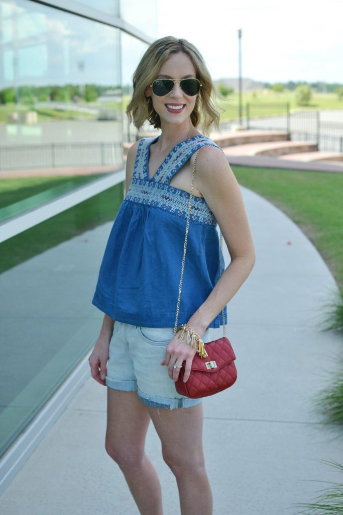 madewell denim top, boyfriend shorts, red bag, fringe bracelet