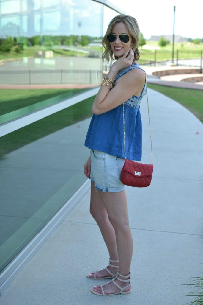 madewell denim top, jean shorts, red bag, fringe bracelet, rebeca minkoff sandals