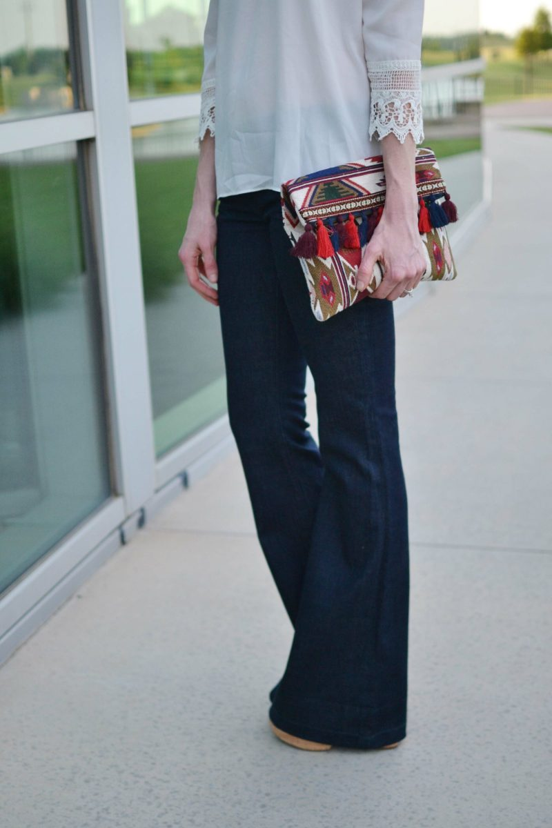flare jeans, off the shoulder top, platforms, clutch