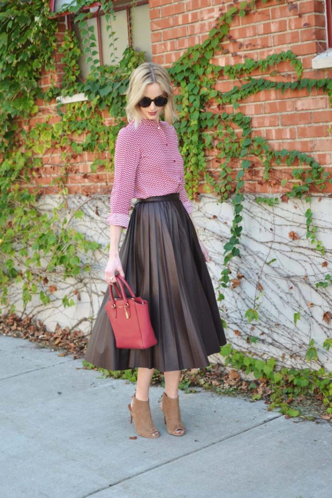 burgundy-pleated-leather-midi-skirt-patterned-red-top-red-bag-karen-walker-sunglasses